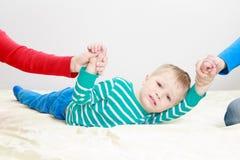 Divorced parents holding sad child separately Royalty Free Stock Photo