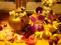 Diwali. Deepavali, praying altar decorated with petals, and flowers. Copper water jug with puti Stock Images