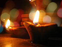Diwali Background. A beautiful background of traditional Diwali lamps with blur effects of colorful lighting
