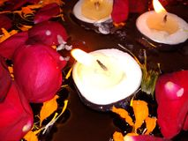 Candle light. Diwali candle light with water and some flower stock photography