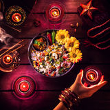 Diwali celebration. Vegetarian biryani, candles, incense and religious symbols at Diwali celebration on the table Royalty Free Stock Photos