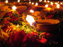 Diwali Decoration. Traditional earthen oil lamps lit with flowers and petals for a holy ritual during Diwali festival in India Royalty Free Stock Photography