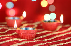 Diwali Diya with blurred festive lights Stock Photos