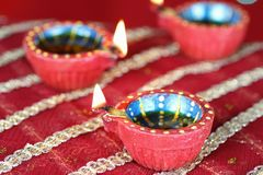 Diwali Diya with blurred lights Stock Images