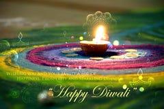 Diwali diya on colorful rangoli Stock Image