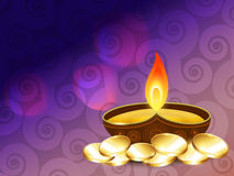 Diwali diya with gold coins Stock Image