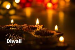 Diwali feliz - cartão do diwali com diya iluminado Fotografia de Stock