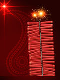 Diwali festival crackers. On artistic red background Royalty Free Stock Image