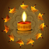 Diwali festival diya reflection on artistic colorful background Stock Image