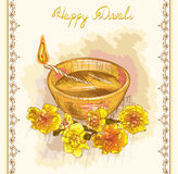 Diwali festive candle and yellow flowers Royalty Free Stock Image