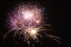 Diwali Fireworks. A sparkler held up against the backdrop of fireworks during a festival in India Stock Photography