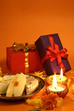 Diwali Gifts and sweets. Gifts, lit lamps, sweets on the occasion of traditional Indian festival Diwali. copy space on top stock photo