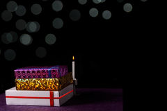Diwali gifts with white bokeh and candle Royalty Free Stock Photo