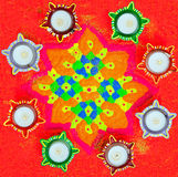 Diwali Lamps around Rangoli Stock Image