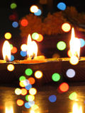 Diwali Lamps and Colors. A view of traditional Diwali earthen lamps through colorful blur lights Royalty Free Stock Image