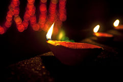 Diwali lamps lit up on a row. Traditional earthen Diwali lamps lit up in a line  during Diwali festival in India Royalty Free Stock Photography