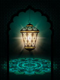 Diwali lantern shining over dark background Royalty Free Stock Images