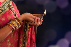 Diwali light. Diwali or deepavali photo with female hands holding oil lamp during festival of light