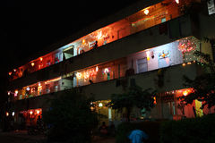 Diwali Lighting. A residential building traditionally decorated with colorful lights and sky-lanterns, on the occasion of Diwali festival in India Stock Images