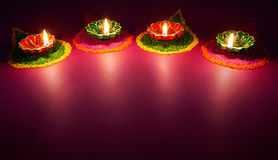 Diwali oil lamp. Colorful clay diya lamps lit during diwali celebration Stock Photography