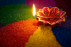 Diwali oil lamp. Diya lamp lit on colorful rangoli Stock Photo