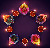 Diwali Oil Lamp. Happy Diwali - Colorful diya lamps in a circle formation