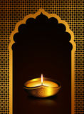 Diwali oil lamp over dark brown  background Royalty Free Stock Photos