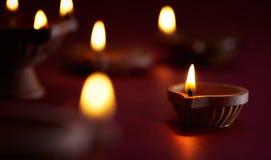 Diwali oil lamp. Traditional clay diya lamps lit during diwali celebration Stock Image