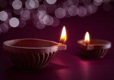 Diwali oil lamp. Traditional clay diya lamps lit during diwali celebration