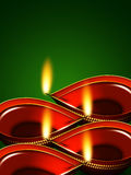 Diwali oil lamps over green background Royalty Free Stock Photo