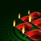 Diwali oil lamps over green background Stock Photos