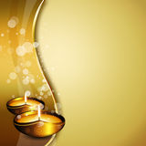 Diwali oil lamps with place for text. Oil lamps with diwali greetings over gold background