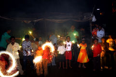 Diwali in Poverty. Street kids celebrate Diwali by traditionally enjoying firecrackers and sparklers donated by a NGO Royalty Free Stock Photo
