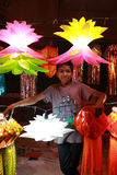 Diwali Seller. A poor Indian boy proudly displays traditional lamps for sale on occassion of Diwali festival in India Royalty Free Stock Photos