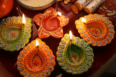 Diwali thali with decorated diya. Top view of traditional diwali (Indian festival) thali with lit decorated diyas with swastik, sweets, fruits