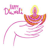 Diwali vector illustration. Indian festival of lights. Diwali vector illustration with hand and diya lamp. Indian festival of lights Royalty Free Stock Photos