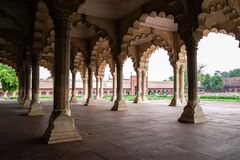 Diwan-I-Am Hall of Audience in Agra Red Fort from inside with ambient light creating soft shadows and overexposed bright sky as