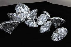 Dix diamants sur le tissu noir Photographie stock