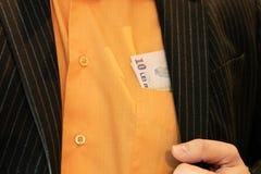 Dix Lei roumain collant hors de la poche images libres de droits