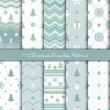 Dix modèles sans couture géométriques de Noël dans les couleurs blanches, bleues et grises illustration de vecteur