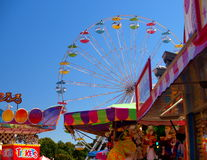 Dixie Classic Fair. Colors line the sky and the midway at the Dixie Classic Fair in Winston-Salem, North Carolina Stock Image