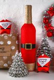 Diy bottle Santa. Guide on the photo how to make the decor of the bottle in the form of Santa Claus of red paint or paper and hemp. Rope. Handmade The decor stock photo