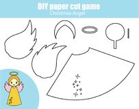 DIY children educational creative game. Paper cutting activity. Make a New Year, Christmas angel figure with glue. DIY children educational creative tutorial Stock Photos