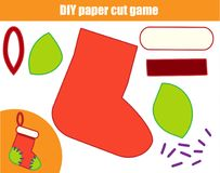DIY children educational creative game. Paper cutting activity. Make a New Year, Christmas sock with glue. DIY children educational creative tutorial game. Paper Royalty Free Stock Photography