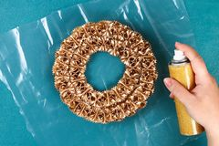 Diy Christmas pasta wreath on blue background. Gift idea, decor Christmas, Xmas, New Year. Step by step. Top view. Process kid children craft. Workshop stock photo
