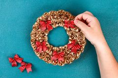 Diy Christmas pasta wreath on blue background. Gift idea, decor Christmas, Xmas, New Year. Step by step. Top view. Process kid children craft. Workshop stock photography