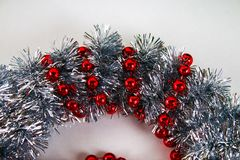 Diy Christmas wreath. Guide on the photo how to make a Christmas wreath with your own hands from a cardboard plate, tinsel, beads. Bows and balls. Handmade The stock images