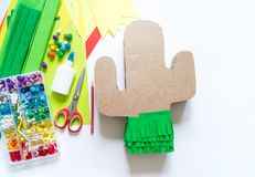 Diy cinco de mayo Mexican Pinata cactus made cardboard and crepe paper your own hands on a white background. Gift idea, decor, game cinco de mayo. Step by step stock photography