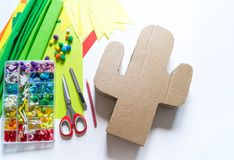 Diy cinco de mayo Mexican Pinata cactus made cardboard and crepe paper your own hands on a white background. Gift idea, decor, game cinco de mayo. Step by step royalty free stock photography