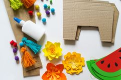 Diy cinco de mayo Mexican Pinata llama made cardboard and crepe paper your own hands on a white background. Gift idea, decor, game cinco de mayo. Step by step royalty free stock images